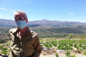 William visiting vineyards in a mask